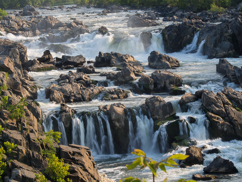 At Great Falls, the Potomac River builds up speed and force as it falls over a series of steep, jagged rocks.